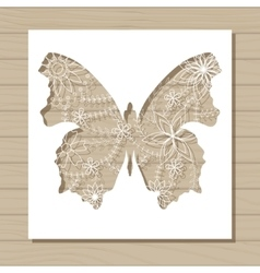 Stencil template of butterfly on wooden background vector