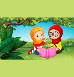 Two muslim girls reading book in park vector
