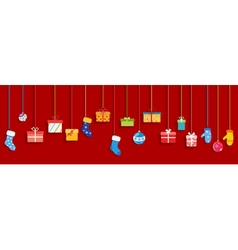 Hanging gift boxes socks and christmas balls vector image
