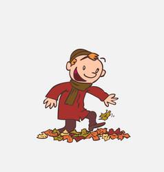 child having fun treading autumn leaves vector image vector image