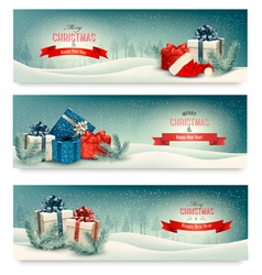 Three christmas banners with presents vector