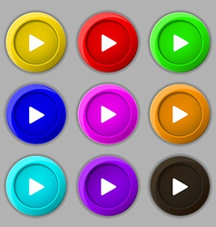Play icon sign symbol on nine round colourful vector