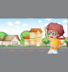 A boy jogging in front of the neighborhood vector image