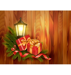 Christmas background with presents and a lantern vector