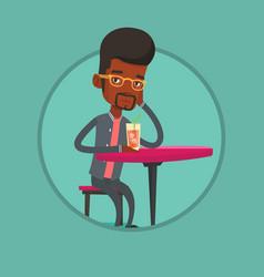 Man drinking cocktail at the bar vector