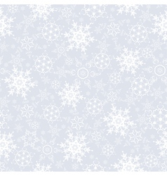 Festive seamless pattern with snowflakes vector