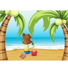 A beach with a young girl playing vector image