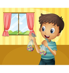 A boy holding two packs of bean candies vector image vector image