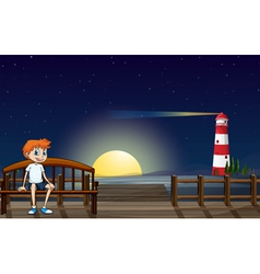 A boy sitting at the bench in the wooden bridge vector image vector image