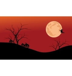 Silhouette of pumpkins and full moon vector