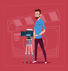 Man holding camera on tripod modern video blogger vector