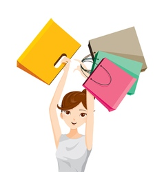 Woman raises her arms holding shopping bags vector