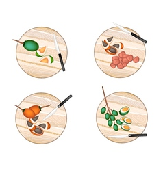 Areca nut fruit on a cutting boards vector