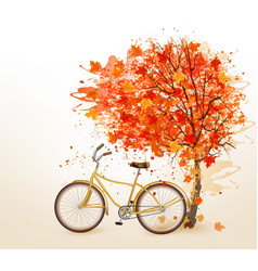 Autumn tree background with a yellow bicycle vector image