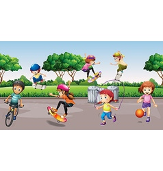 Children playing sports in the park vector image