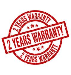 2 years warranty round red grunge stamp vector