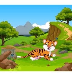 Funny baby tiger cartoon in the jungle vector