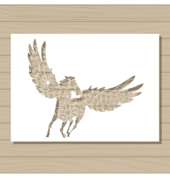 Stencil template of pegasus on wooden background vector