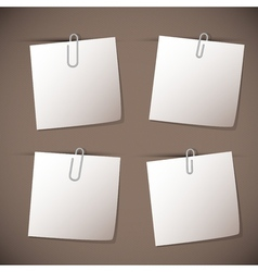 Note papers with paperclip on brown background vector image
