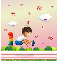 A boy exercising in the candyland vector image vector image