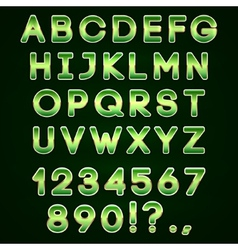 Golden and green neon alphabet on dark background vector