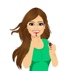 Woman applying pink lipstick on lips vector