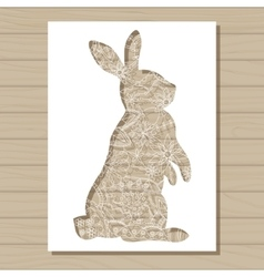Stencil template of rabbit on wooden background vector