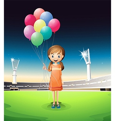 A girl holding balloons standing in the middle of vector image