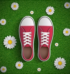 Vintage sneakers standing on green grass vector