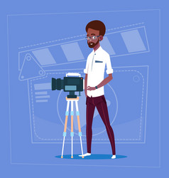African american man holding camera on tripod vector