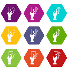 Hand holding playing cards icon set color vector