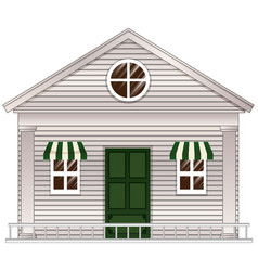 White cottage with green door vector