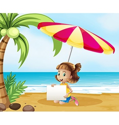 A girl at the beach under the umbrella with an vector image vector image