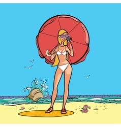 Girl in swimsuit by the sea with a sun umbrella vector