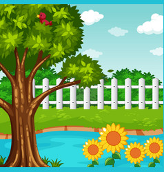 Garden scene with pond and flowers vector