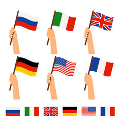 Hands holding flags of different countries vector