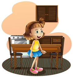 A little girl in the kitchen wearing a blue skirt vector