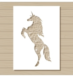 Stencil template of unicorn on wooden background vector