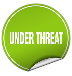 Under threat round green sticker isolated on white vector