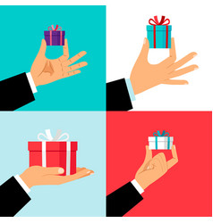 Hand holding small gift box set vector