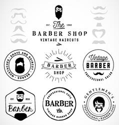 Vintage barber shop badges and labels vector