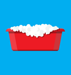 red plastic basin with soap suds bowl with water vector image vector image
