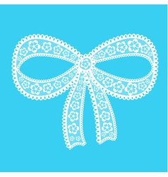 Decorative lacy bow on blue background vector
