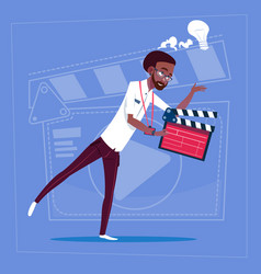 African american man holding clapperboard modern vector