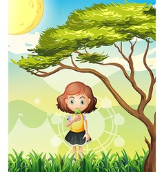 A small girl near the big tree vector image