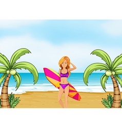 A female surfer at the beach vector