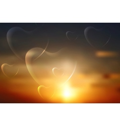 Shiny hearts on sunset sky background vector image vector image