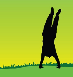 Handstand on green grass black silhouette vector