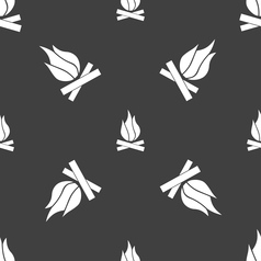 A fire icon sign seamless pattern on a gray vector