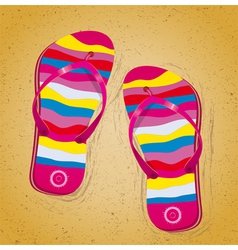 Beach slippers on sand vector
